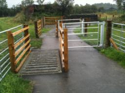 There are cattle grids and gates to allow animals to move between the fields on either side of the path.
