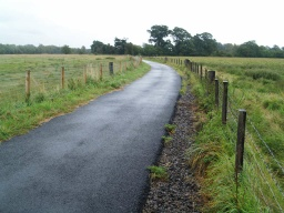 The path has a tarmac surface throughout and is wide enough for two people to walk side by side with plenty of space for cyclists to pass safely.