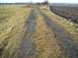 The track is uneven and muddy in places.