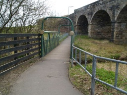 This route crosses the burn and goes under the railway arches.