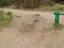 The end of the trail is blocked by a green barrier and earth mounds prevent easy access onto other trails in the area.Return the way you came.