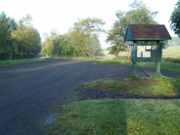 The car park has a firm surface of crushed stone though it may be uneven in some places.In information board give details of walks and other amenities in the area.