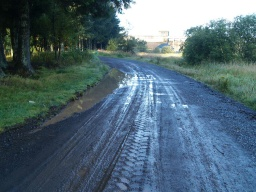 The road may have puddles after wet weather and have an uneven surface.