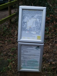 Two small information panels are next to the path inside the kissing gate.