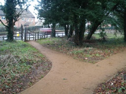 At the junction to the access points into the park take the path to the right.