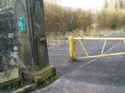 There is a barrier at the entrance but a gap to the side which is wider than 1.2m.