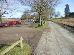 Colemere site entrance. There are plenty of parking spaces, although none are designated for disabled visitors. The surfacing in the car park is rather rough and uneven.