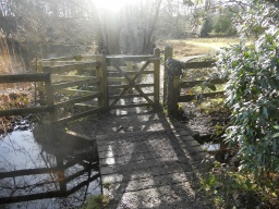 A kissing-gate stands at the entrance to Little Mill Field.