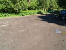 The surface of the car parking area (OS grid ref NS 964 870) is of crushed stone and may have puddles after wet weather.The walks starts by the green barrier at the back of the car park.