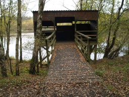 The hide has a level entrance and viewing windows at different heights.The ramp is covered with chicken wire to prevent it becoming slippery but care may be needed if it is worn or broken as it may be a trip hazard or it could even puncture a wheelchair tyre.