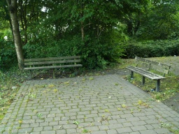 There is a small seating area at the start of the trail.