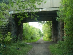 The surface of the path is a little uneven under the bridge carrying Hound Hill Lane