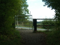 The gate onto Hound Hill Lane opens both ways and has an easy to use latch.