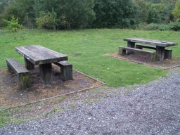 There are two picnic tables close to the trail.