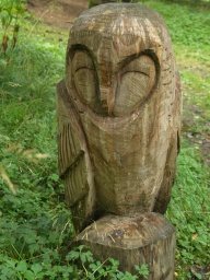 A sculpted owl adorns the arboretum.