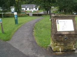 The Duke's Trail starts by the sign showing a map of the route.The toilet block can be seen in the distance.