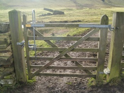 The gate is 1m wide and easily opened either way by a latch that can be used at high and low levels. There may be an uneven and muddy surface under the gate at times.