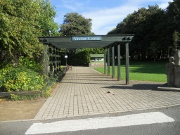 Cross the road to the Visitors Centre and follow the line of the pergola and block paving