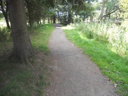 The approach to Castle Bridge is well-surfaced and maintained. Turn right onto the bridge to re-join the Gardens Walk.