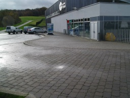 The Falkirk Wheel Visitor Centre is at the start of the circular walk to the higher level Union Canal. The start of the circuit can be seen on the left.