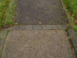 The path changes from a sealed surface to crushed stone though it remains firm and even.