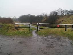 From the car park go through the gap in the barrier. This is less than 815mm wide.