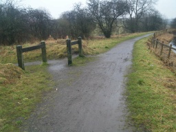 The barriers are at the junction with a path connecting to Banknock. Stay on the tow path by the canal to reach Underwood Lockhouse.