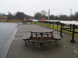 There are several picnic tables in the car park on the other side of the canal from Underwood Lockhouse.