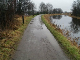 There may be puddles across the path after wet weather but the surface is general firm and even.