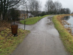 Keep right on the tow path to head towards the Falkirk Wheel. The path to the left leads down to Main Street. The slope has a gradient as steep as 23% (1 in 4) there is a seat a short way down the slope.
