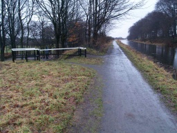 Keep right along the tow path.The path to the left trough the barrier leads to Falkirk Road.