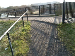 By the bridge at lock 4 there is an uneven surface just before a small step (50mm high) onto the tarmac surface.Across the bridge there is a ramp down onto Abbots Road.