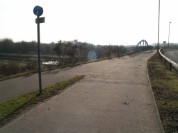 The track to the left leads down from the A9 cycleway onto the canal tow path.