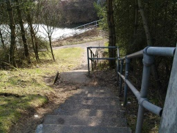 There are steep steps with a handrail down to the canal from the bridge over the railway.