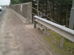 The top of the steps from the canal tow path join the footway on the right.