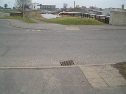 Turn left just before the canal bridge and cross The Matlings onto the tow path with the canal on your right.