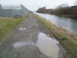 There are a few pot holes and puddles after wet weather.