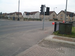 Turn right at the main road and then cross at the drop kerbs at the traffic lights.