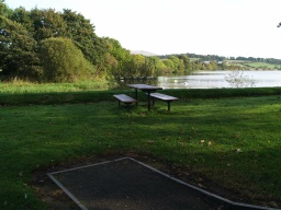 There are 20 picnic tables or benches located off the path all the way round the walk though they are not evenly spaced.