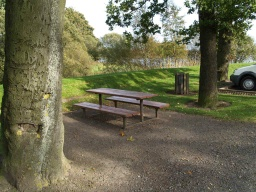 Picnic tables beside the disabled car park
