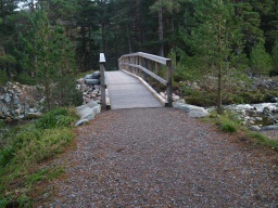 The recently installed bridge has as gentle ramp leading to it. It is wide enough for two people to cross side by side.