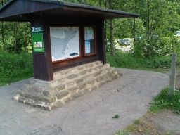 Maps of the walks are displayed on the information board near the toilet block