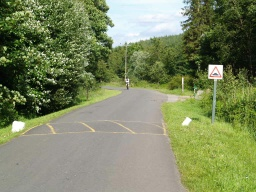 The road can be used to get back to the visitor centre or visitors can return along the riverside. Cyclists, horse riders and motorists use this road. There is no separate footway.