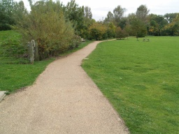 The path is wide enough for two people to walk side by side throughout.