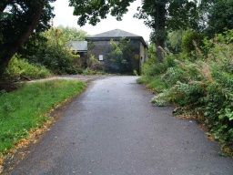 Stay on the path to pass the old stable block.