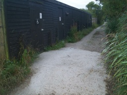 The Public Hide displays the international access sign. Access is by the door which opens outwards.