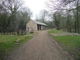 A picnic area is located next to the restored stable block.