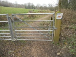 The wicket gate is fitted with a lever-bar and latch mechanisms. The gate opens in both directions, making it easier to operate.
