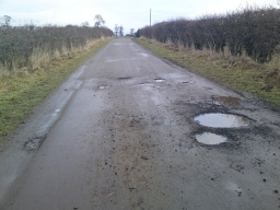 There are a few more pot hole`s but not many.  The road can have dirt on it from tractor tyre`s.