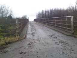 Looking up the bridge north 10%  (1:10).  The road can get muddy.  Also, please keep an eye out for farm vehicles.